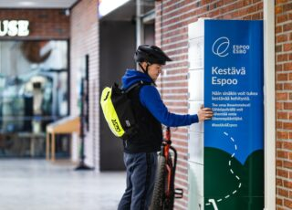 Electric bicycle charging station and user in A Bloc